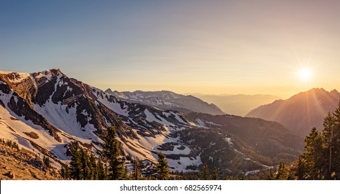 Panorama of a summer sunset in the Mountains at Snowbird Ski and Summer Resort, Little Cottonwood Canyon, Utah.