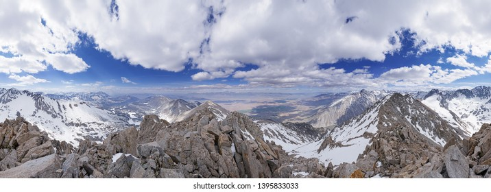 panorama from the summit of Wheeler Crest in the Sierra Nevada Mountains of California in the spring with a lot of snow and clouds in the sky