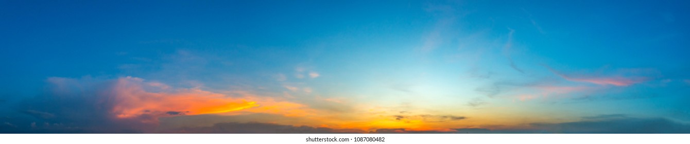 panorama Sunlight with dramatic blue and orange sky.Vivid sky on dark clouds.Long shots photo background for use.