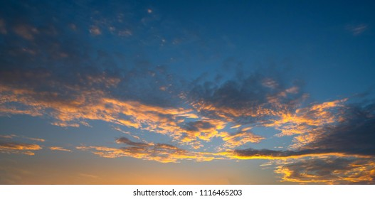 panorama Sunlight with dramatic sky. Cumulus sunset clouds with sun setting down on dark background.orange cloud sky.