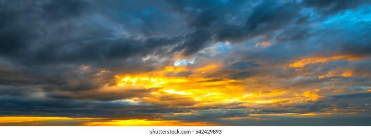 panorama Sunlight with dramatic sky on dark background.Vivid sky on dark cloud.
