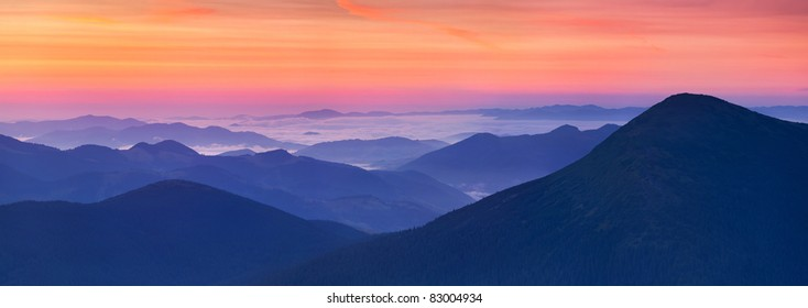 panorama of sunrise in the mountains