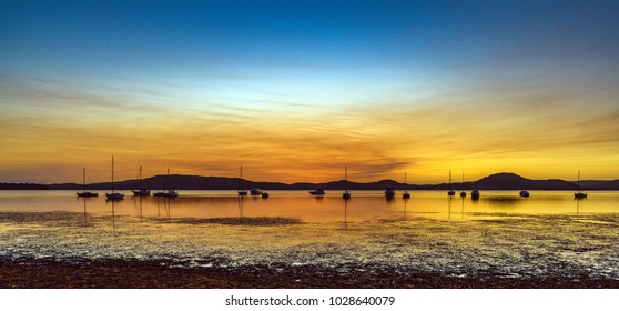 Panorama Sunrise Seascape with Boats - Capturing the sunrise from Koolewong Foreshore on the Central Coast, NSW, Australia.