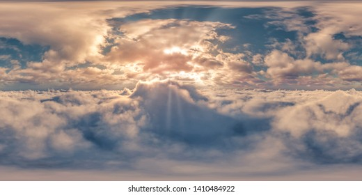 360° Panorama - Sunset above sea of clouds and God Rays