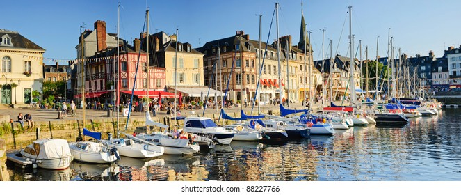 Panorama. Sunset in Honfleur. View of the old harbor - boats, houses