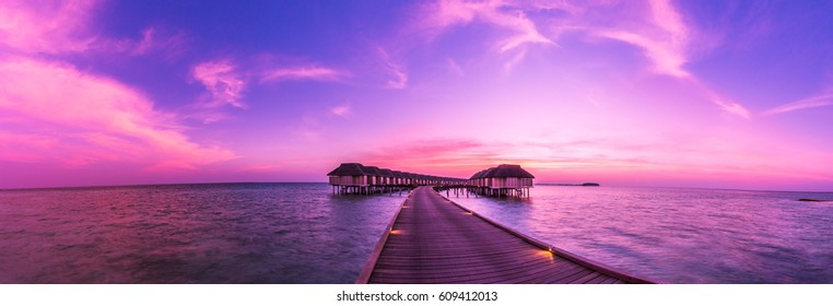Panorama sunset landscape in Maldives. Beautiful twilight sky and colorful clouds. Beautiful beach background for vacation holiday banner