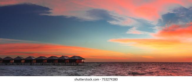 Panorama of a sunset on a maldivian island