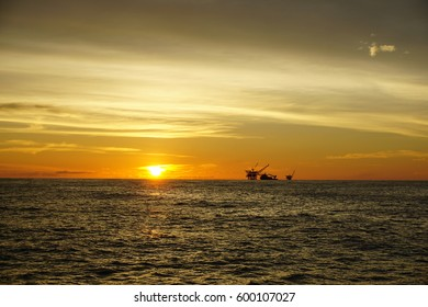 Panorama of the sunset on the sky with silhouette of offshore platform at South China Sea.