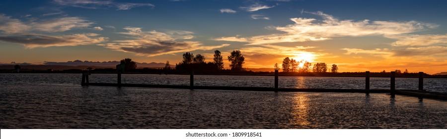 Panorama  of sunset on water Jetty Island Port Gardner Everett Washington
