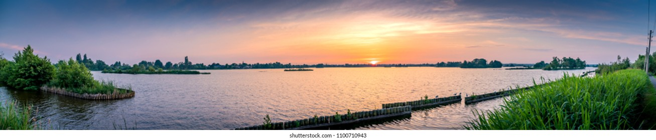 Panorama sunset over lake area in Reeuwijk, the Netherlands