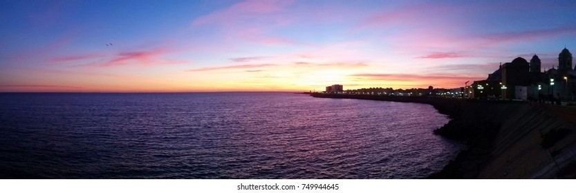 Panorama of the sunset over the old city of Cadiz and The Atlantic Ocean in the south of Spain, Europe