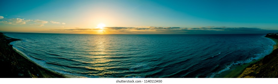 Panorama of Sunset at sea shore
