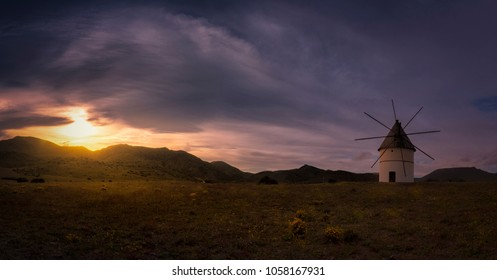 Panorama of sunset in a Windmill abandoned at Pozo de Los Frailes, Almeria, Andalusian, Spain.