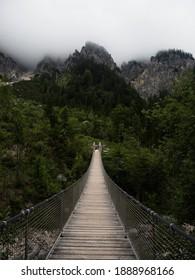 Panorama of suspension bridge Klausbachtal Berchtesgaden National Park near Ramsau Bavaria Germany alps mountains