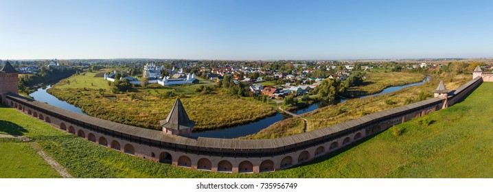 Panorama of Suzdal with the fortress wall of the Spaso-Evfimiev Monastery, the river Kamenka and a view of the Intercession Monastery.
