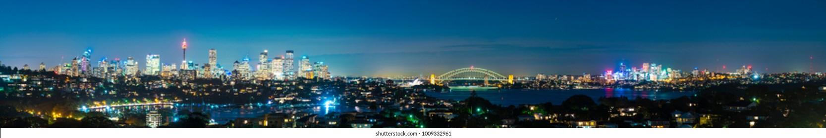 Panorama of Sydney at night with view of CBD, Harbour Bridge and Opera House