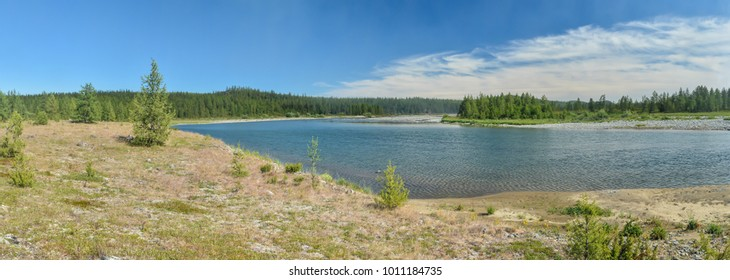Panorama of the taiga river in the Polar Urals. Summer water landscape in the north of Russia.