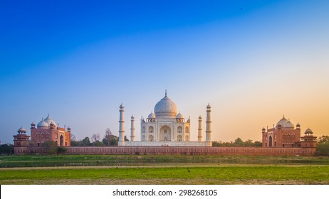 Panorama of the Taj Mahal from north side across the Yamuna river at sunset.