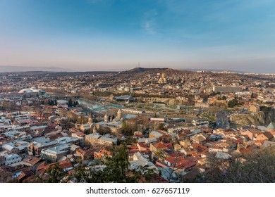 Panorama of Tbilisi, Georgia in sunset rays. Vivid, saturated, splittoned image.