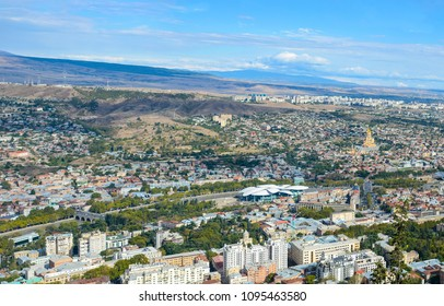 Panorama of Tbilisi (residential areas, the old churches, new creative buildings.
