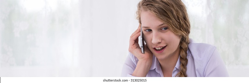 Panorama of teen girl being on the phone