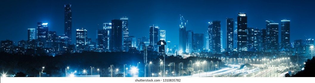 Panorama Of Tel Aviv City And Ayalon Freeway At Night - View of Tel Aviv at night. - Toned In Blue Color