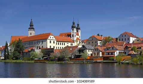 Panorama of Telc. Telc is a town in southern Moravia in the Czech Republic. Telc Castle and city reflected in lake. The historic center of Telc is a UNESCO World Heritage Site