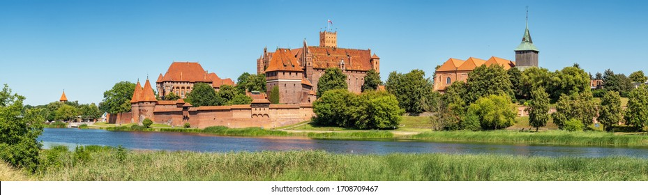 Panorama of Teutonic Castle in Malbork or Marienburg at summer in Pomerania, Poland
