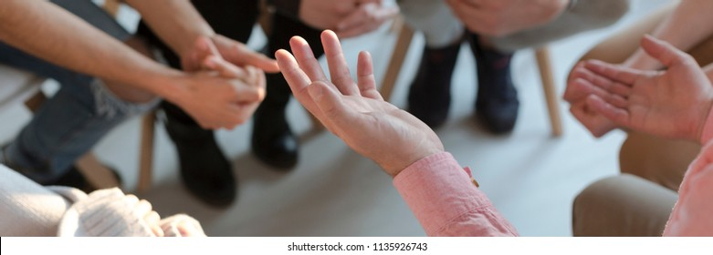 Panorama of therapist's hands while gesticulating during group therapy
