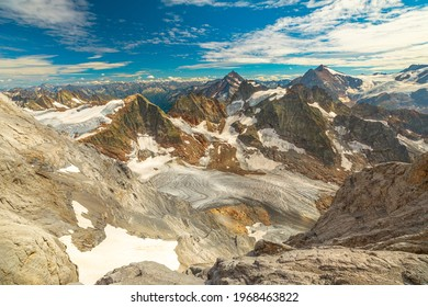 Panorama from Titlis suspension bridge on top of Titlis glacier in the Uri Alps. Cantons of Obwalden and Bern. Switzerland, Europe in summer season. The highest suspension bridge in Europe.