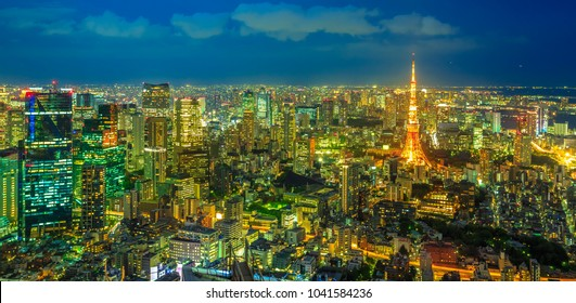Panorama of Tokyo Skyline at blue hour with illuminated Tokyo Tower from observatory in Roppongi Hills complex, Minato District, Tokyo, Japan. Aerial view