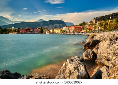 Panorama of Torbole a small town on Lake Garda, Italy. Europa..Soft focus due to long exposure shot,beautiful Lake Garda surrounded by mountains in the summer time