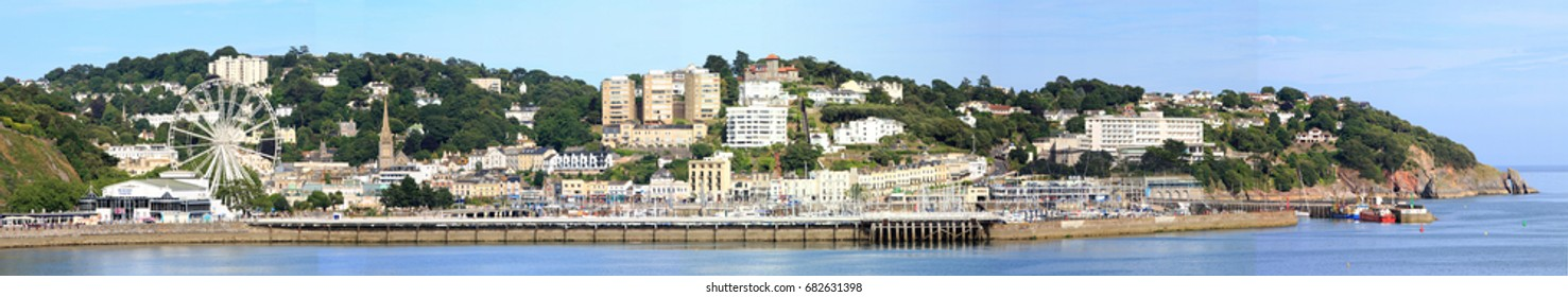 Panorama of Torquay promenade and harbour in Devon which is located in the English Riviera - Torbay.  It is a popular place for tourists in the summer months, Devon, England 2017
