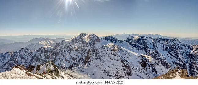 Panorama of Toubkal and other highest mountain peaks of High Atlas mountains in Toubkal national park, Morocco, North Africa