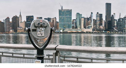 Panorama of tourist binoculars at Long Island City, Queens, New York with Manhattan skyline in the background