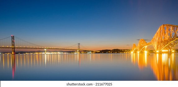 Panorama of the tow bridges over the Firth of Forth in Scotland at dawn