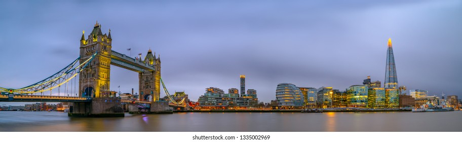 Panorama of Tower Bridge in London with dark cloudy sky