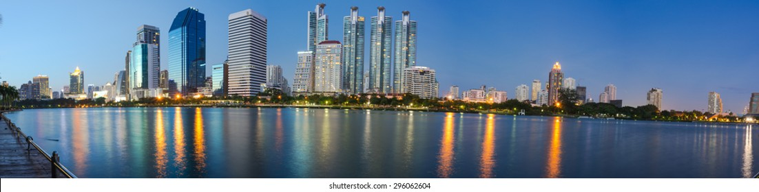 Panorama tower night landscape with water reflection.
