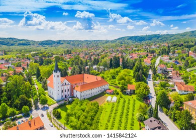 Panorama of Town of Samobor in Croatia, catholic church and monastery, aerial view from drone, green countryside landscape