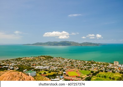 Panorama of Townsville, Queensland, Australia, with Magnetic Island in the background, seen from Castle Hill viewpoint. Magnetic Island is a popular tourist destination. Harbour and beaches.