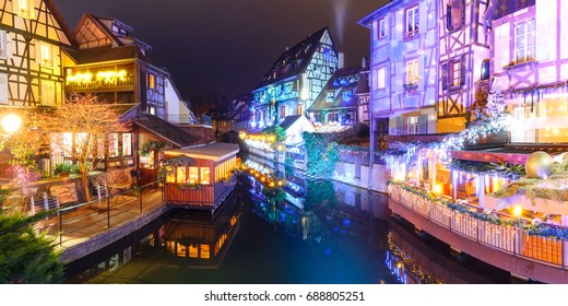 Panorama of traditional Alsatian half-timbered houses and river Lauch in Petite Venise or little Venice, old town of Colmar, decorated and illuminated at christmas time, Alsace, France