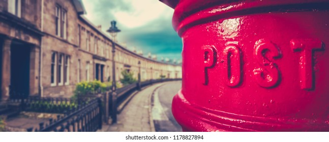 Panorama Of A Traditional British Red Post Box In A Curved Edwardian Terrace Street With Shallow Depth Of Focus