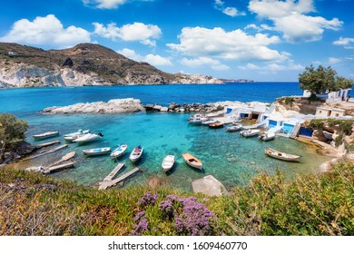 Panorama of the traditional Greek fishing village of Mandrakia, a syrmata settlement with boat houses directly by the sea, Milos, Cyclades, Greece