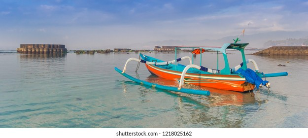 Panorama of a traditional indonesian fishing boat at the Candidasa coast of Bali, Indonesia