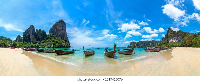 Panorama of Traditional long tail boat on Railay Beach, Krabi, Thailand in a summer day