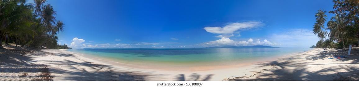 Panorama of the tropical beach and ocean coastline