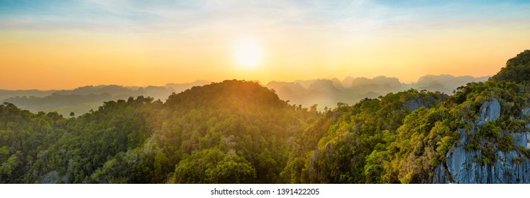 Panorama of tropicall landscape with dramatic sunset and steep mountain ridge on horizon. Krabi, Thailand
