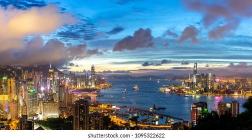 Panorama Urban cityscape skyline at night in Hong Kong