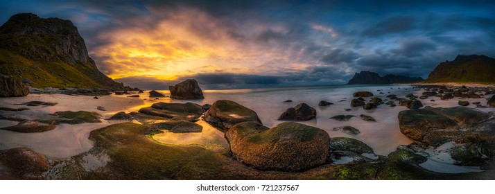 Panorama of the Uttakleiv beach on Lofoten islands in Norway at dramatic sunset. Long exposure.