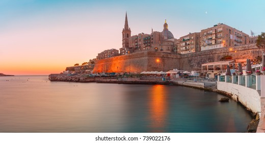 Panorama with Valletta Skyline with churche of Our Lady of Mount Carmel and St. Paul's Anglican Pro-Cathedral, at dawn, Valletta, Capital city of Malta